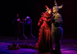 Vocally talented Jenny Gee nicely overcame a microphone failure in her role as the Dragon. PHOTO: Len Bates
