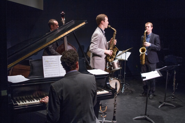 Jab Patton on piano, Clovis Nicolas on acoustic bass, Will Anderson (light suit) on alto sax, and Peter Anderson (dark suit) on tenor sax. Photo by Eileen O'Donnell