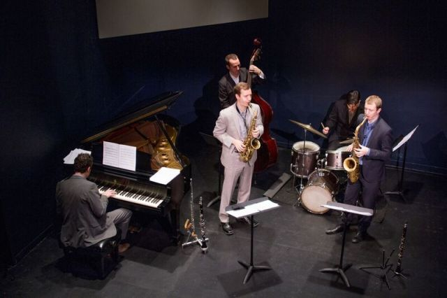 Jab Patton on piano, Clovis Nicolas on acoustic bass, Phil Stewart on drums, Will Anderson (light suit) on alto sax, and Peter Anderson (dark suit) on tenor sax. Photo by Eileen O'Donnell