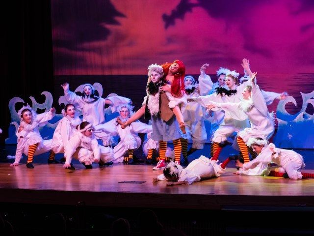 The seagulls surround Anderson McDaniel as Scuttle and Jenny Gee as the Mermaid PHOTO: Leonard Bates