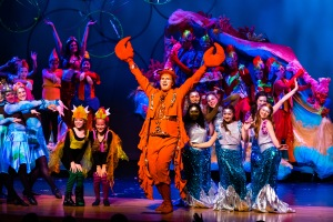 Brad Brickhouse as Sebastian with the cast of The Little Mermaid PHOTO: Leonard Bates