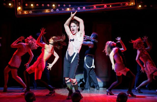 Randy Harrison as the Emcee and the 2016 National Touring cast of Roundabout Theatre Company's CABARET.  Photo by Joan Marcus.