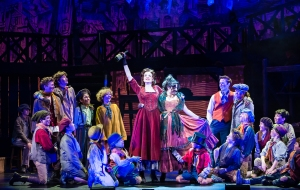 Kathryn Porterfield as Nancy and the cast of OLIVER!