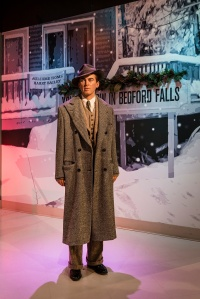 """Jimmy Stewart figure revisits Bedford Falls, the setting of his role in the beloved Christmas movie """"It's a Wonderful Life,"""" at Madame Tussaud's Wax Museum in the Hollywood section of Los Angeles, California"""